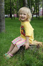 Free Little Girl Sitting On A Stump Stock Photography - 14708852