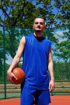 Free Basketball Player On The Sportground Royalty Free Stock Photos - 14702138