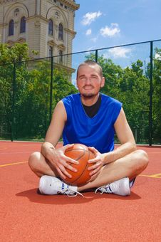 Basketball Player With Basketball Ball Stock Photos