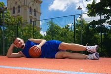 Free Young Man With Basketball Ball Relaxes Stock Images - 14702274