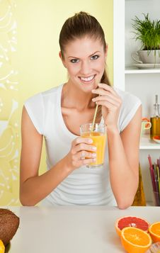 Free Young Beauty Woman With A Glass Of Orange Juice Stock Photography - 14703182