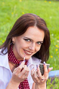 Free Cute Lady Performing Makeup Stock Photos - 14704553