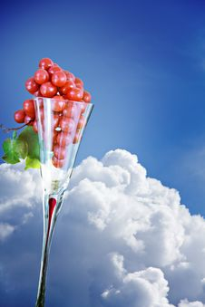 Free Grapes In An Elegant Glass Against Blue Sky Royalty Free Stock Image - 14704656