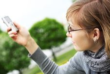 Free The Girl Holds A Mobile Phone In Hands Royalty Free Stock Images - 14704699