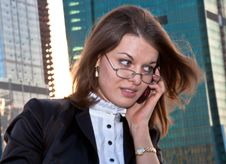 Young Business Lady Speaking Over The Mobile Phone Stock Photo