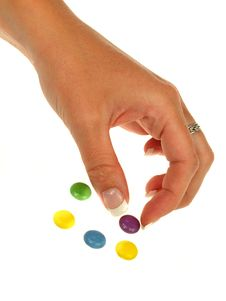 Free Woman Hand With Bonbons Stock Photos - 14705373