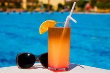 Free Glass Of Tasty Juice With Pipes And Sunglasses. Royalty Free Stock Photography - 14705387