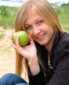 Free Woman With Green Apple Stock Photo - 14705690