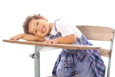 Adorable Little Boy Sitting In A Desk Stock Images