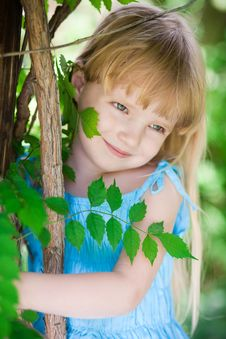 Free Little Girl In Blue Dress In The Park Royalty Free Stock Images - 14707169