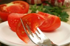 Tomato Wedge On Fork Stock Photo