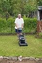 Free Man Cutting Grass At Suburban House Royalty Free Stock Photos - 14713188