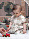 Free Portrait Of A Little Kid With Toy Car Stock Photography - 14718002