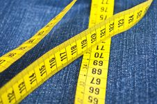 Blue Jeans And Measure Tape Stock Images
