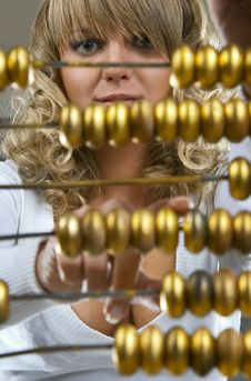Free Girl Calculating With An Abacus Royalty Free Stock Photography - 14715727
