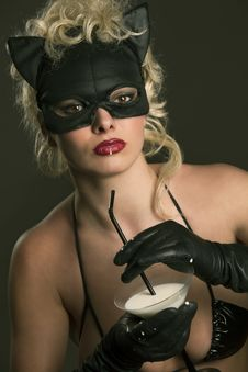 Free Blond Girl Wearing Black Cat, Drinking Milk Stock Image - 14715761