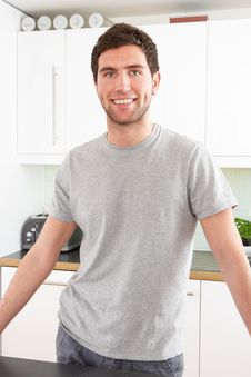 Free Young Man Relaxing In Modern Kitchen Royalty Free Stock Image - 14718196