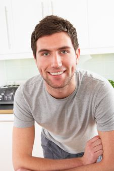Free Young Man Relaxing In Modern Kitchen Royalty Free Stock Photos - 14718208