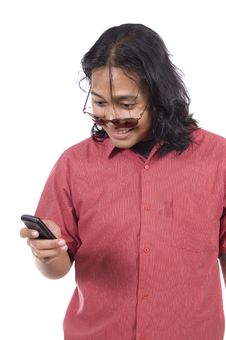 Long Hair Man With Cellphone Royalty Free Stock Photography