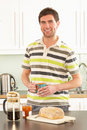 Free Young Man Preparing Breakfast In Kitchen Stock Photo - 14720310