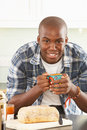 Free Young Man Preparing Breakfast In Kitchen Stock Photography - 14720312