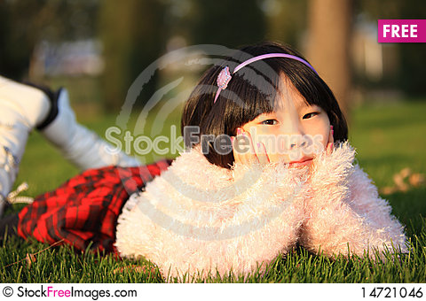Free Asian Girl Lying On Grass Royalty Free Stock Image - 14721046