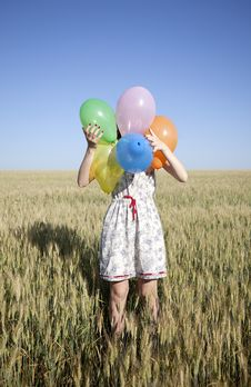 Girl With Balloons At Wheat Field Stock Photos