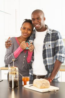 Free Young Couple Preparing Breakfast In Kitchen Royalty Free Stock Photography - 14720387