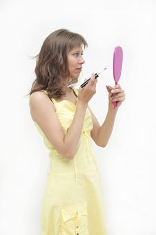 The Young Woman Looks In A Mirror Stock Photography