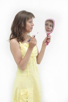 The Young Woman Looks In A Mirror Royalty Free Stock Photo