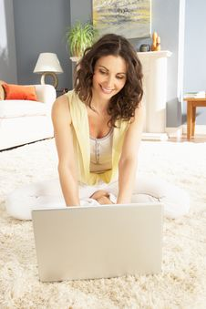 Free Woman Using Laptop Relaxing Sitting On Rug At Home Stock Photo - 14724090