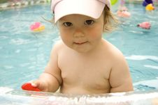 The Child With The Big Eyes In Pool Royalty Free Stock Photography