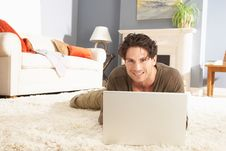 Free Man Using Laptop Relaxing Sitting On Rug At Home Royalty Free Stock Images - 14724609