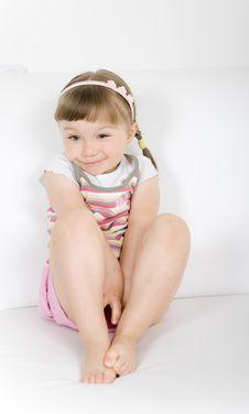 Free Little Girl On Sofa Stock Image - 14725051