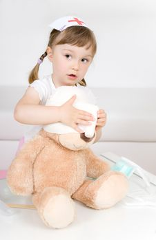 Free Little Girl Doctor With Teddy Bear Stock Image - 14725101