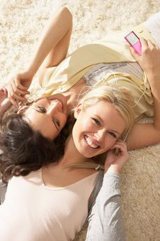 Free Two Women Listening To MP3 Player On Headphones Stock Image - 14726201