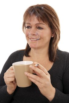 Woman With Coffee And Cigarette Stock Image