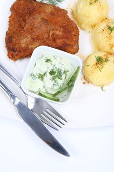 Pork Chop , Potatoes, Cucumber Salad Royalty Free Stock Image