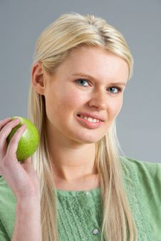 Free Woman Relaxing On Sofa Eating Apple At Home Stock Images - 14729334