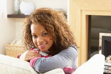 Woman Relaxing On Sofa At Home Royalty Free Stock Photo