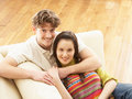 Free Romantic Young Couple Relaxing Sitting On Sofa Royalty Free Stock Images - 14731609