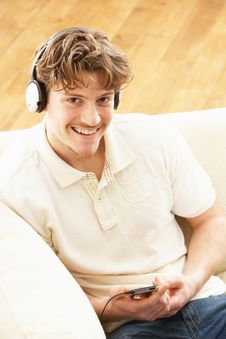 Free Man Listening To MP3 Player On Headphones Royalty Free Stock Images - 14731689