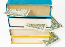 Books With Dollar Bookmarks Royalty Free Stock Photography