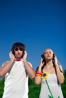 Free Boy And Girl In Headphones Royalty Free Stock Image - 14736446