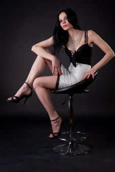 Free Beautiful Young Woman Sitting On Chair Royalty Free Stock Images - 14738669