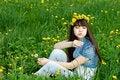 Free Girl Sitting Among Dandelions Royalty Free Stock Photos - 14741318