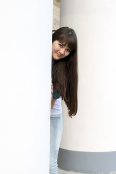 Free Girl Hiding Behind Column Royalty Free Stock Photo - 14740545