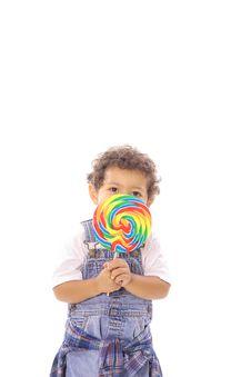Free Toddler Peeking Behind Lollipop Royalty Free Stock Photography - 14740847