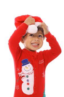 Free Toddler Fixing Santa Hat Stock Image - 14741041