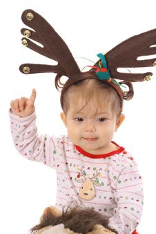 Free Baby On Pony With Reindeer Ears Stock Photography - 14741132